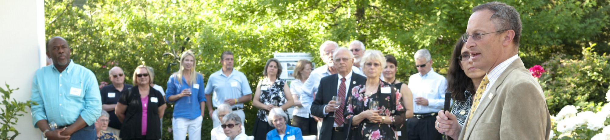 Image of Provost Hexter addressing UC Davis Arboretum and Public Garden donors and members.
